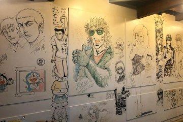 Drawing by Shinji Hiramatsu (middle)