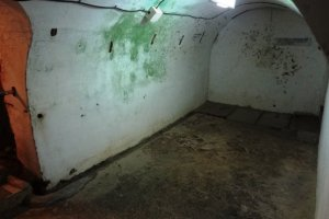 The spots on the walls are the aftermath of seppuku at the Former Japanese Navy Underground Headquarters