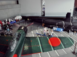 """There is a """"large objects room"""" with a collection of military aircraft and other objects."""