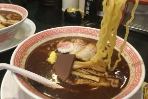 It really is ramen underneath. The base is shoyu (soy sauce) broth.