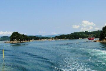 A pirate ship plies the waters of Kujukushima National Park