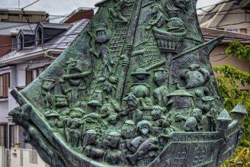 Bronze sculpture on one of the thirteen Ebi River bridges