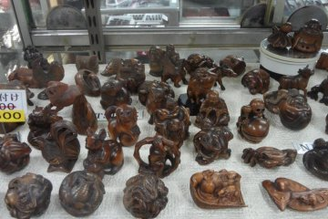 <p>Originally made from ivory, these netsuke are miniature wooden carvings that long ago were designed to be attached to the end of money pouches, tobacco pouches, pillboxes, and (nowadays) cell phones,</p>
