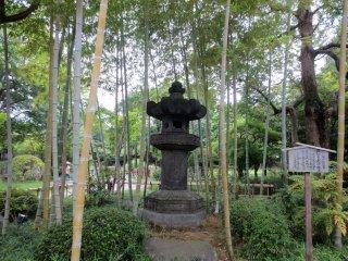Stone lantern hidden in the bamboo in Heisei Garden