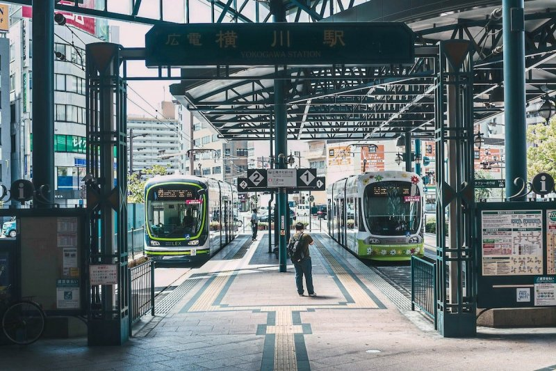 Trams come and go at Yokogawa Station in Hiroshima City