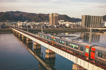 The JR Kabe Line travelling over the Ota River