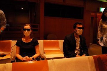 Testing the augmented reality glasses with explanations and subtitiles projected directed into the retina   ©Tatsuya Shiraishi