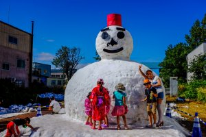 The giant snowman is a popular attraction at the summer festival