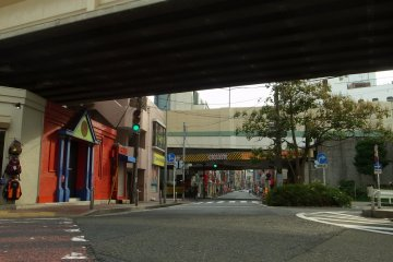 A view under the rail tracks; the road leads to Matsukage-cho