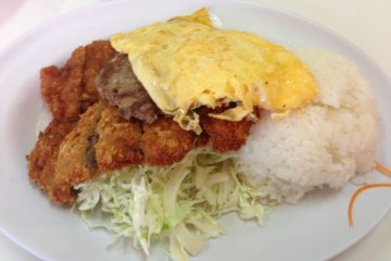 <p>Like a military chow hall, the food at Highway Drive In is stacked high on to the plate</p>