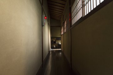 A long narrow corridor leads to the tearoom