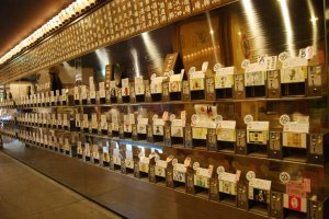 Row of sake mini vending machines at the Ponshukan