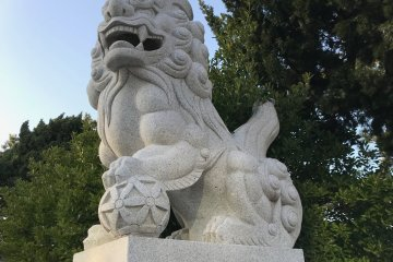 One of the two komainu, or lion-dogs, guarding the entrance to the shrine