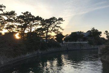 Morito Shrine viewed from Misogi Bridge under a relaxing sunset