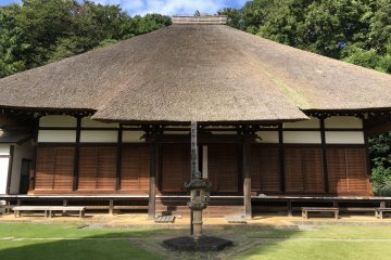 The temple's main hall is known for its thatched roof