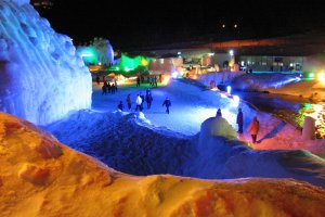 Colorful lights illuminating the ice sculptures