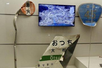 Damaged signs on display.