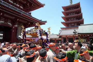 Festival goers carrying a mikoshi