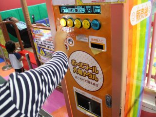 The token machines and the ticket machine for the ball pit look like this