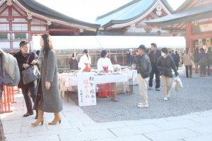 Shrine maidens selling festival items.