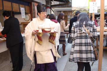 Shinto priest at Hatsu Uma Festival.