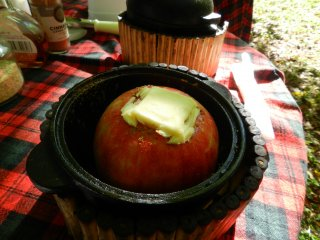 Yes, that is a wedge of butter stuffed into that apple.