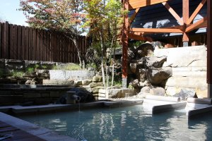 Experience Kusatsu's blue waters at the open air baths