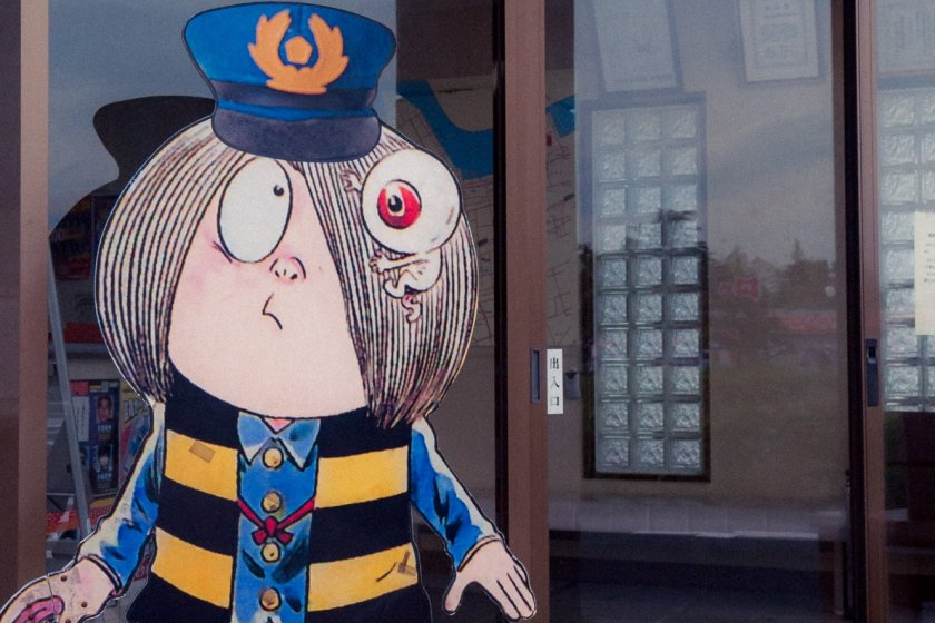 The anime\'s main character (Kitaro) dressed up as a station attendant.