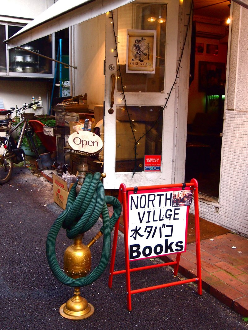 <p>The sign of North Village Books &amp; Shisha shouldn&#39;t be hard to spot given the huge hookah pipe beside it.</p>