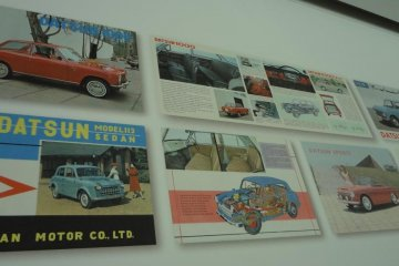 The Heritage Corridor houses a small Nissan photo and plastic model museum. You can find some familiar names on the wall, like DATSUN or Prince.
