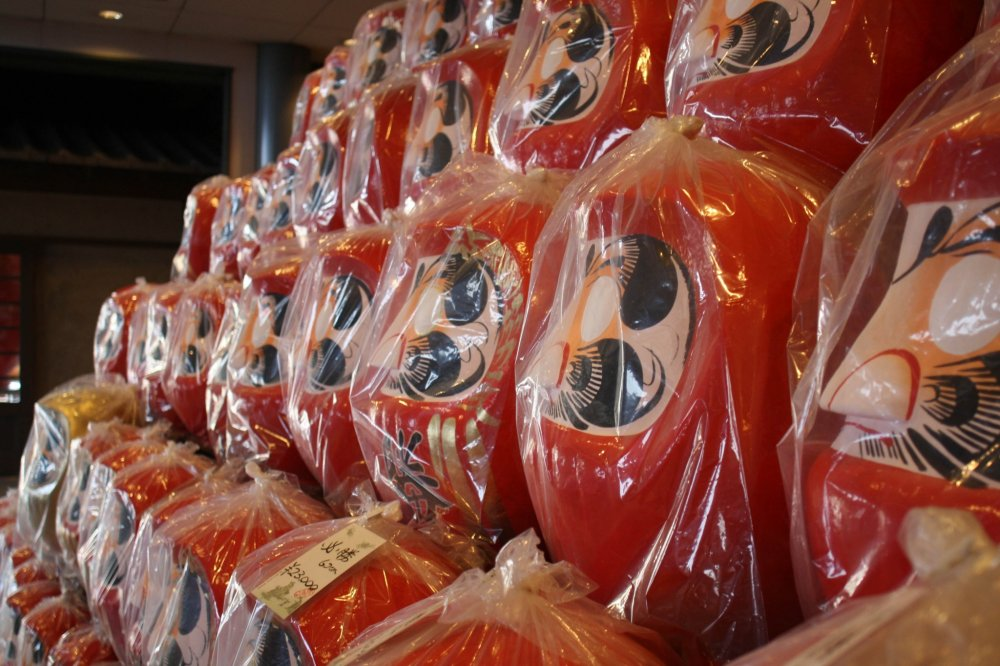 You'll see towers of Daruma dolls as you enter the factory