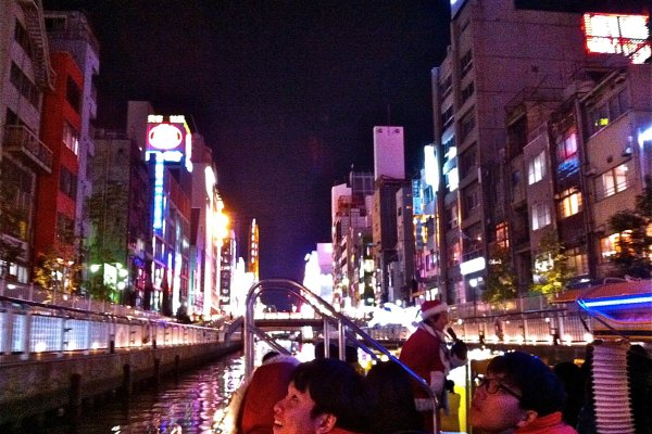 A few of the Tombori River Cruise passengers in awe of the neon lights