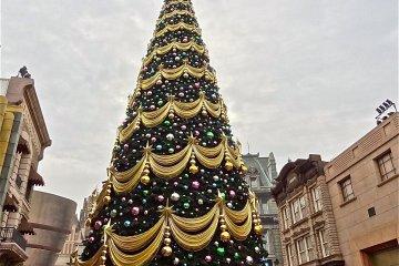 The enormous Christmas tree at Universal Studios Japan during the holiday season