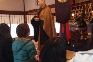 The temple's caretaker greets visitors and will explain the history of the temple as well as instructions for zazen meditation.