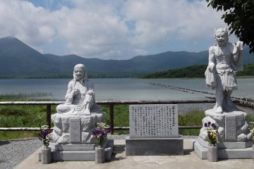 <p>Welcome to hell... statues greeting visitors at the lakeside</p>