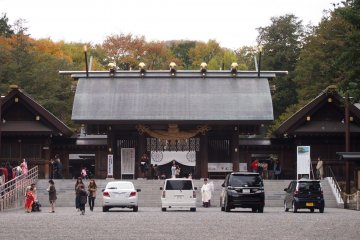 <p>Cars parked at the entrance of the temple were first blessed by a ritual done by the priest.</p>