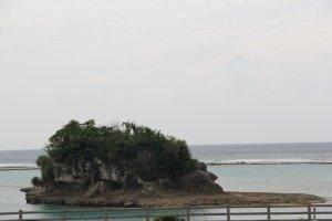 A small island near the beach at the Kadena Marina