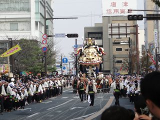 A float is pulled down the main street in Karatsu