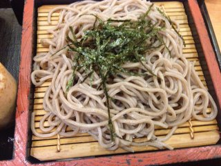 The cold soba is dipped into the accompanying sauce one chopstick full at a time