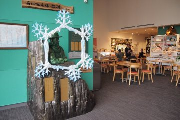 <p>A cafe area selling Asahikawa ramen and a photo corner in Tourism and Local Products Information Center.</p>