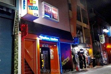 American Bar and Hip Hop Shop at dusk