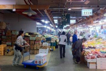 Action at the greengrocer stalls  at Akita Citizens market one of the freshest fish markets north of Tsukiji