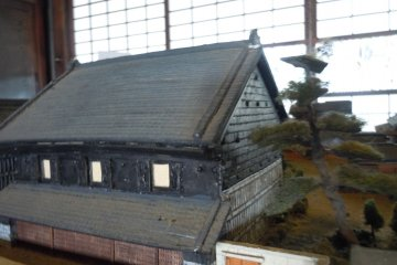 <p>This is a 1/100 scale model of the Shinohara residence and property including three large stone warehouses, just prior to the 1949 bombing attack of the city.&nbsp;</p>