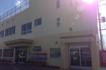 <p>Look for this building on the western most portion of Route 224 just south of the intersection with Route 36 in northern Okinawa City</p>