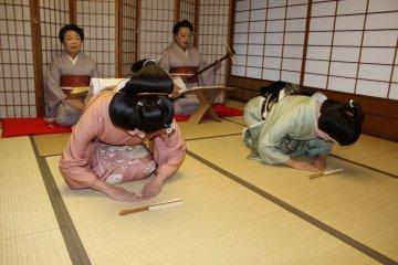 <p>Song by geigi Fu Chiyo, on shamisen geigi&nbsp;Madoka, both bowing beautifully after a performance</p>
