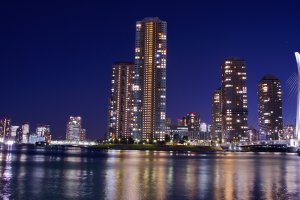 Waterfront and Chuo-Ohashi Bridge with night-time illumination and reflections