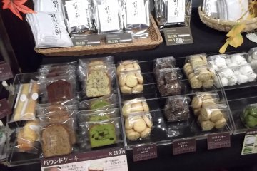 <p>There&#39;s a rack of sweets and other goodies for sale</p>
