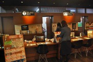 Reception desk at tourism center, Echigo-Yuzawa station.