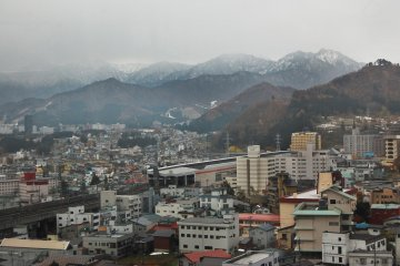 <p>Yuzawa&nbsp;Town from above, covered by snowy mountains</p>