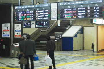 <p>Checking out the train schedule.</p>